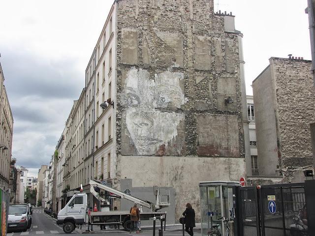 Street Art By Portuguese Artist Vhils On Rue De La Fontaine Au Roi, Paris, France. 3