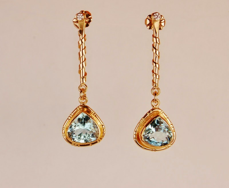 dangling earrings with pear shaped medium blue stones