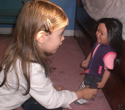 Five year old girl with her new Maplelea Girls doll.
