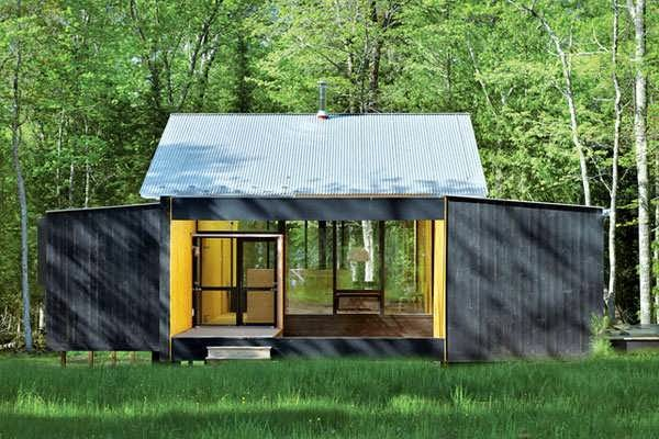 Minimalist prefab cottage modern design in small forest for Prefab cottage plans