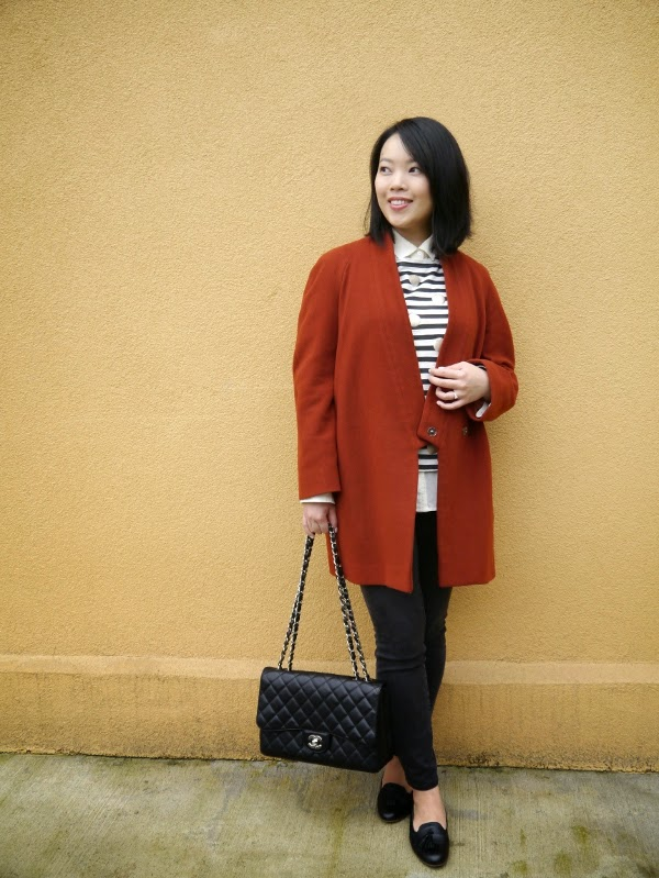 Burnt sienna overcoat, Breton stripes with gold polka dots, jeans, Chanel 2.55, black tassel loafers