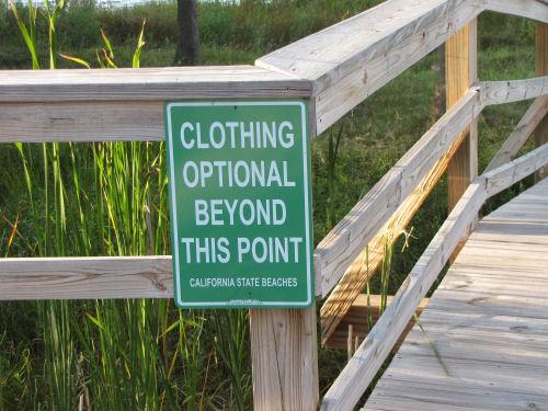clothing optional sign
