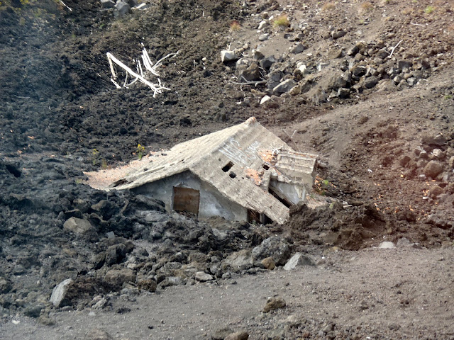 destroyed house at mount etna, sicily