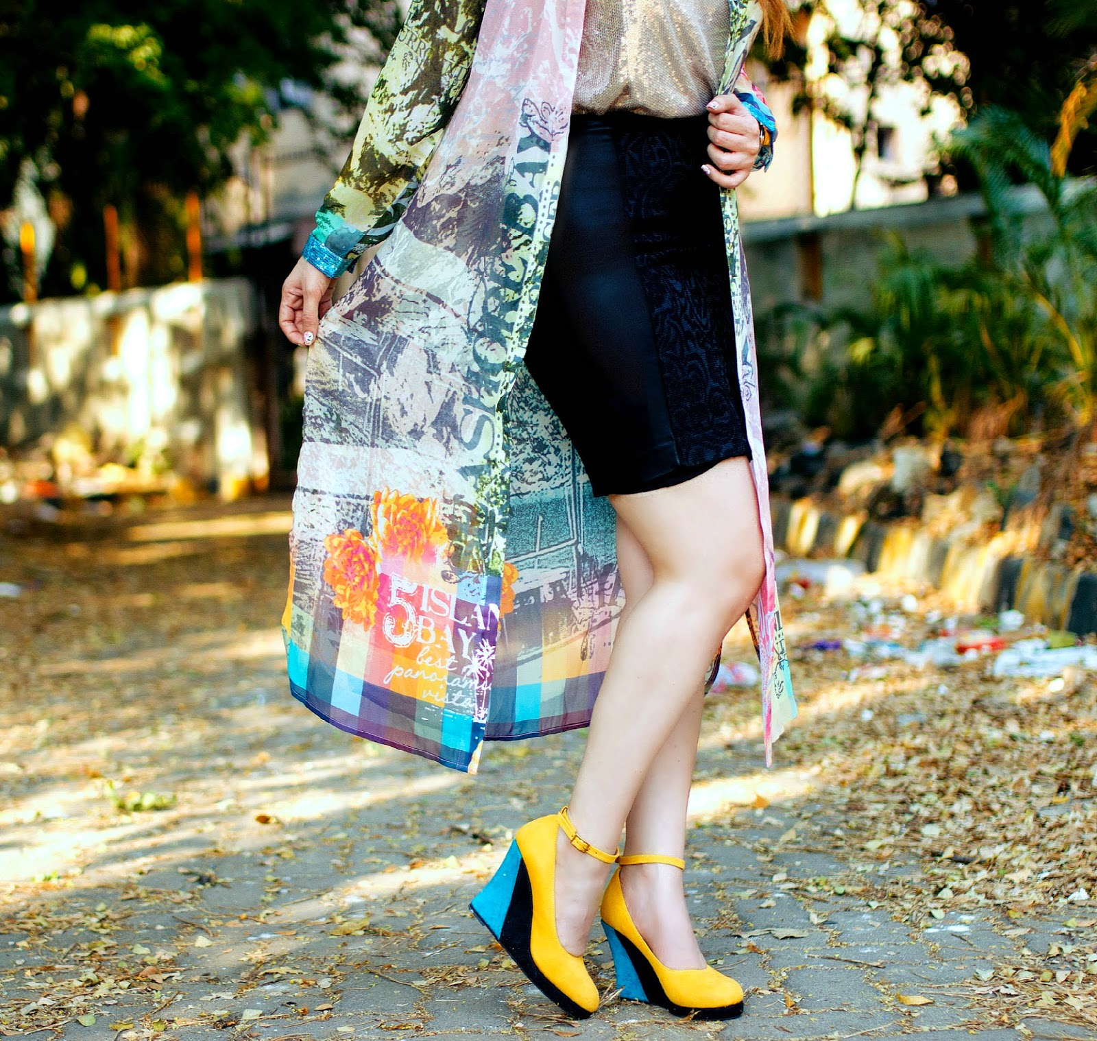 Printed Cape, Black Skirt & Yellow Wedges