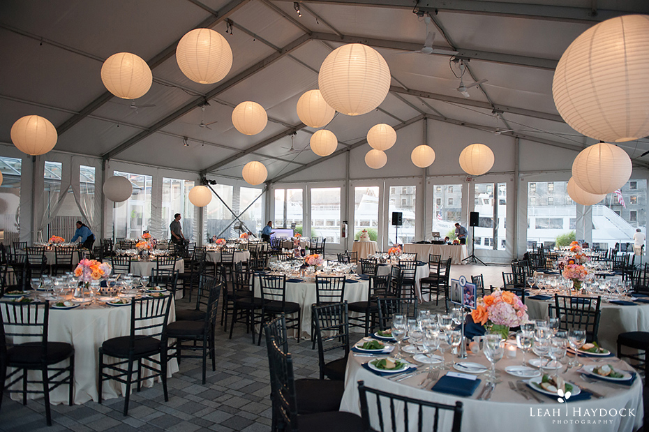 Tented wedding pictures at New England Aquarium with uplighting and lanterns