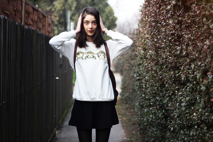 Nora, fashion blogger, wears a cute monkey emoji sweatshirt
