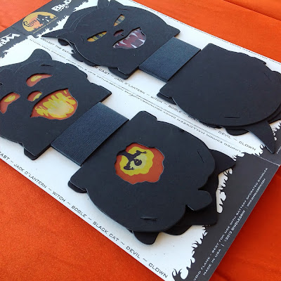 A dark sixpack of vintage style slot-tab candy container lanterns as silhouettes by Halloween artist Bindlegrim