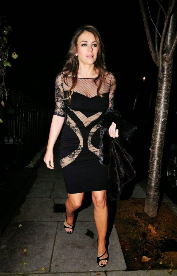 Elizabeth Hurley appeared to showing her another great design of mini dress as she leaved her home on Friday, November 26, 2014.