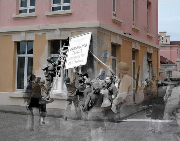 """Rue Dom Pedro, civilians and American soldiers tear down the sign indicating the headquarters of the Todt organization in Cherbourg."""