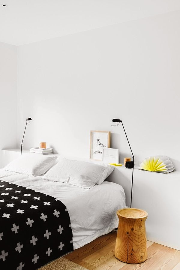 scandi inspired white bedroom with cross blanket