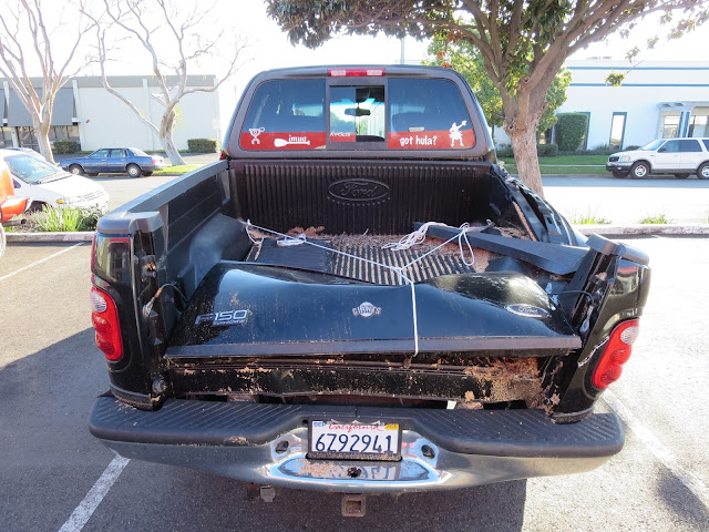 Totalled vehicle with body and frame damage