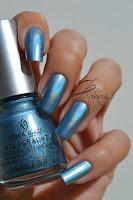 http://kakinenailart.blogspot.fr/2013/11/china-glaze-sci-fly-by-hologlam-bonne.html