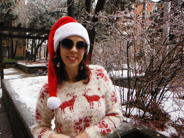 Urban Outfitters Christmas Reindeer Cozy Sweater, Express Tuxedo Jeans, Santa Hat, Nice Naughty Novelty Socks, Vintage Purse Fashion, style Toronto, Canada, Santa Hat, Candy Cane, Boots, Jingle Bell earrings, Sunglasses, Ice Storm