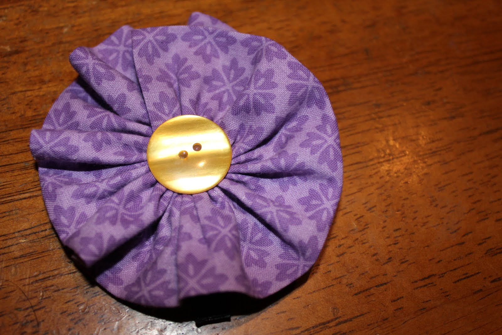 little fabric flower i show you how to make in this video tutorial