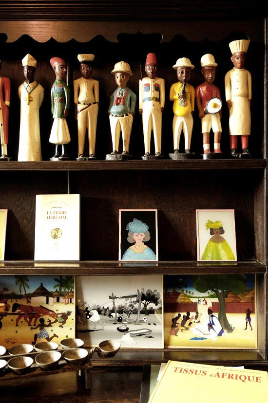Safari Fusion blog | Quirky colonial men | A beautiful book shelf collection of West African Colon statues
