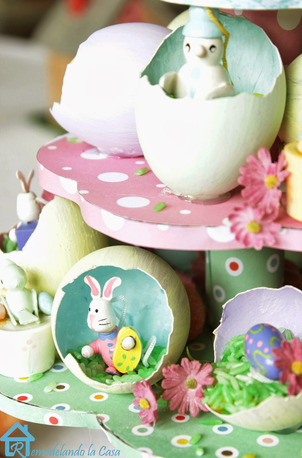 small rabbit, bird and flowers inside egg shells for Easter egg tree centerpiece