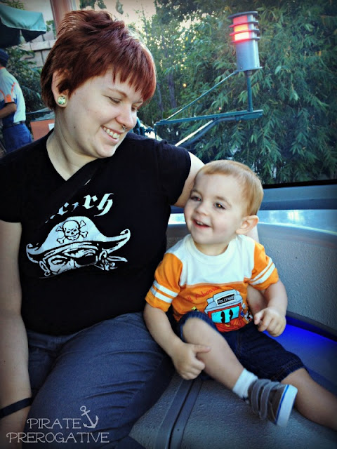Riding the monorail with mommy.
