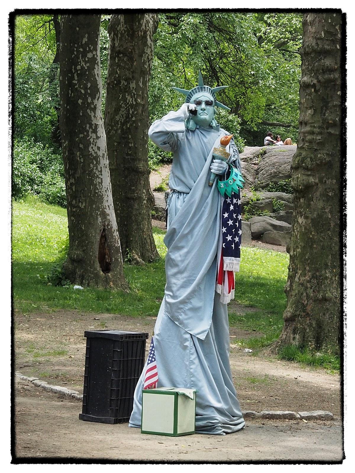 Liberty Calling #statueoflibertystreetperformer #centralpark #nyc 2014