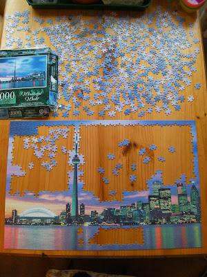 partially completed difficult jigsaw in progress 