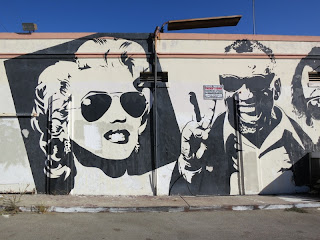 Melroseandfairfax old school mr brainwash mural still riding for Bob marley wall mural