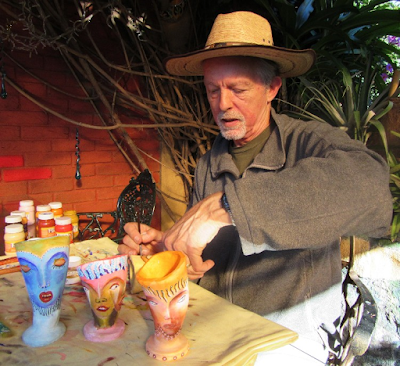 Andrew Carhartt woring at his art pieces in Pátzcuaro