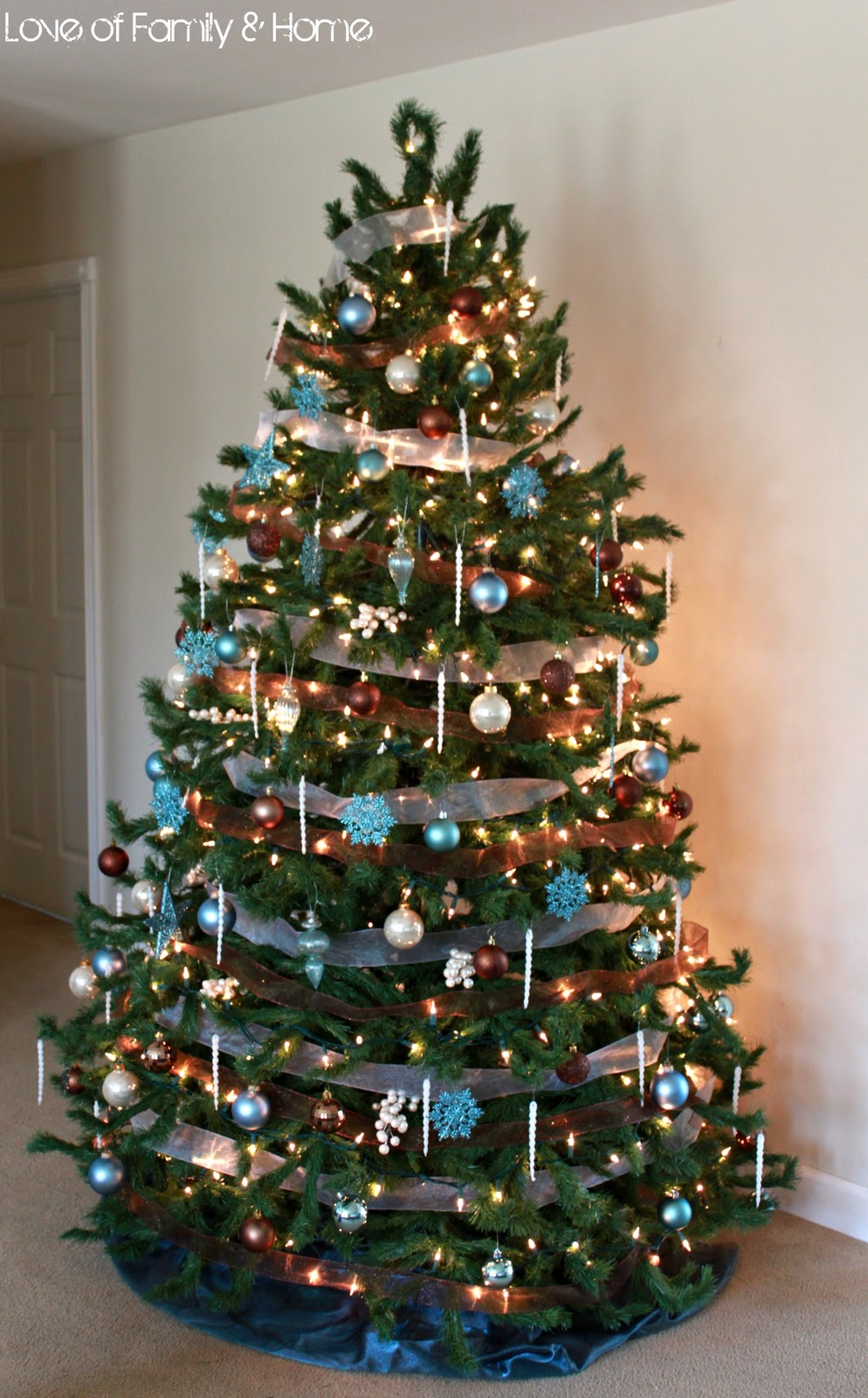 Green christmas tree with blue decorations : My christmas tree love of family home