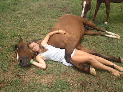 funny girl with her horse