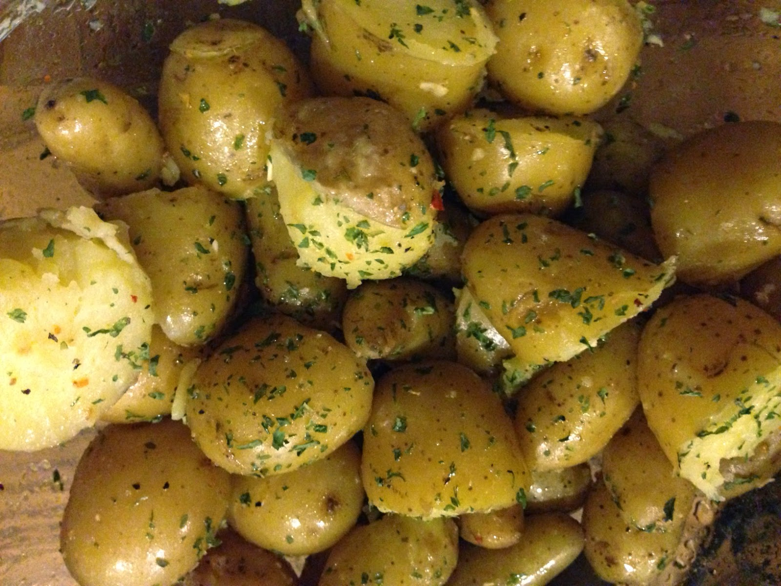 Fingerling and Baby Potatoes tossed in Ghee and sprinkled with herbs