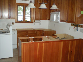 Countertops removed from the cherry cabinets