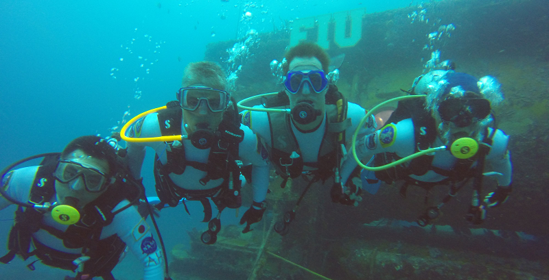 Four 'aquanauts' pose for an photo during their underwater NEEMO 18 training mission. Credit: NASA