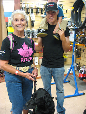 Sue Mooney and Ryder with a cyclist from the USA Pro Cycling Challenge
