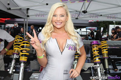 Big smile and lovely peace sign by Lisa Lee Marie, KW Suspensions umbrella girl at Formula Drift New Jersey 2015 event