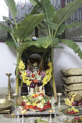 Ganesha and Gauri idols placed in a decorated mandap as part of Ganesh chaturthi celebrations in the South India