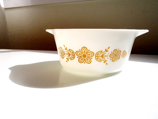 white and orange floral pyrex bowl