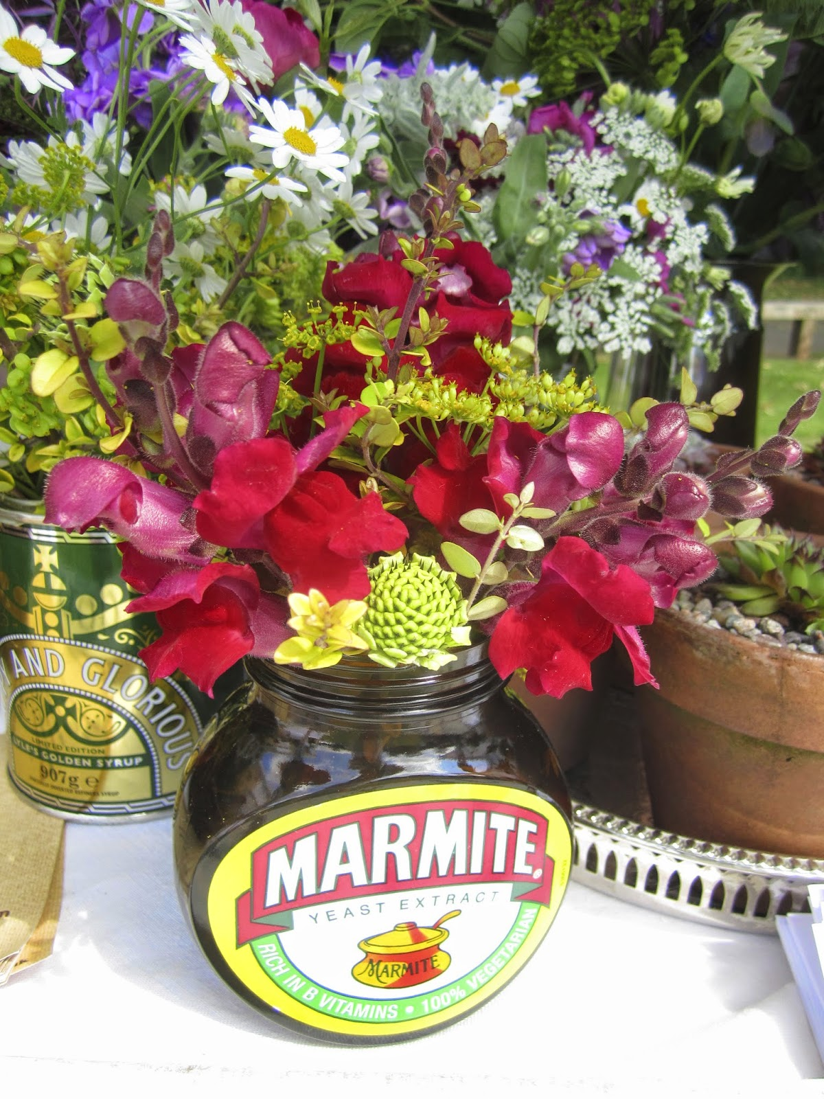 A marmite jar of Tuckshop Flowers.