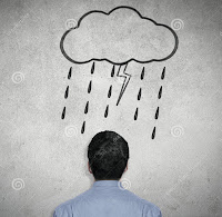 Photo of a man's head from behind, against a gray background, with a sketched cloud raining over his head