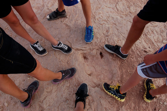 Size Perspective on the Utah Raptor Fossilized Footprint with all of Our Feet in the Picture