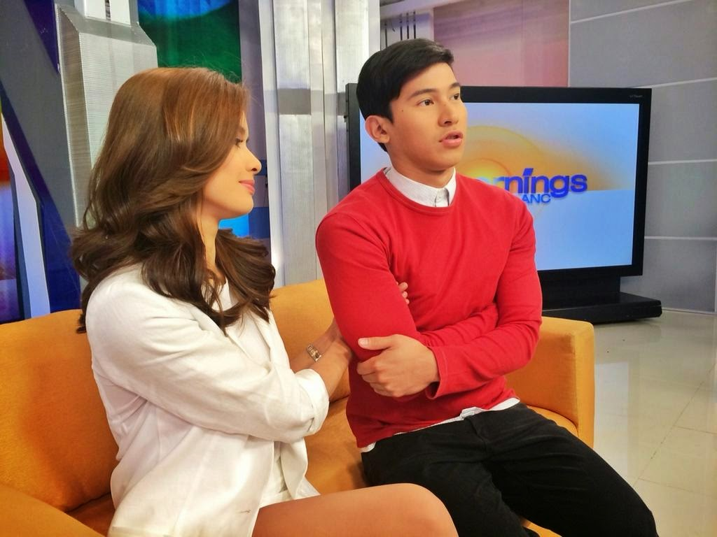 Erich Gonzales' hands underneath Enchong Dee's armpit