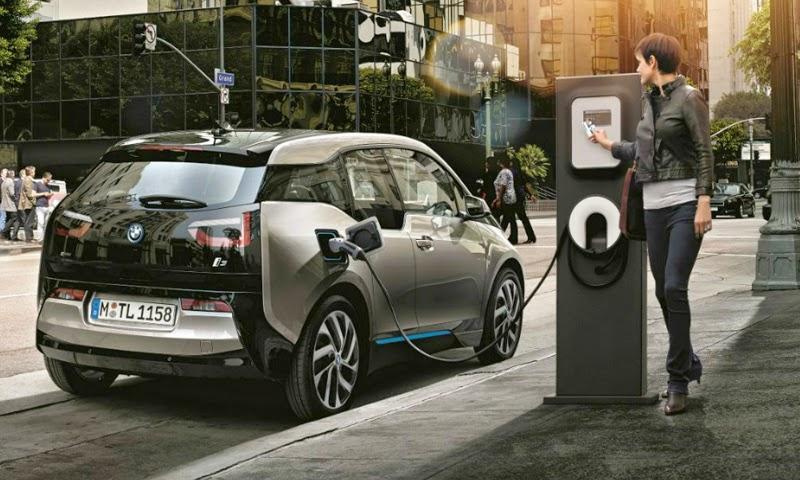 Resultado de imagem para fotos de carros elétricos sendo recarregados