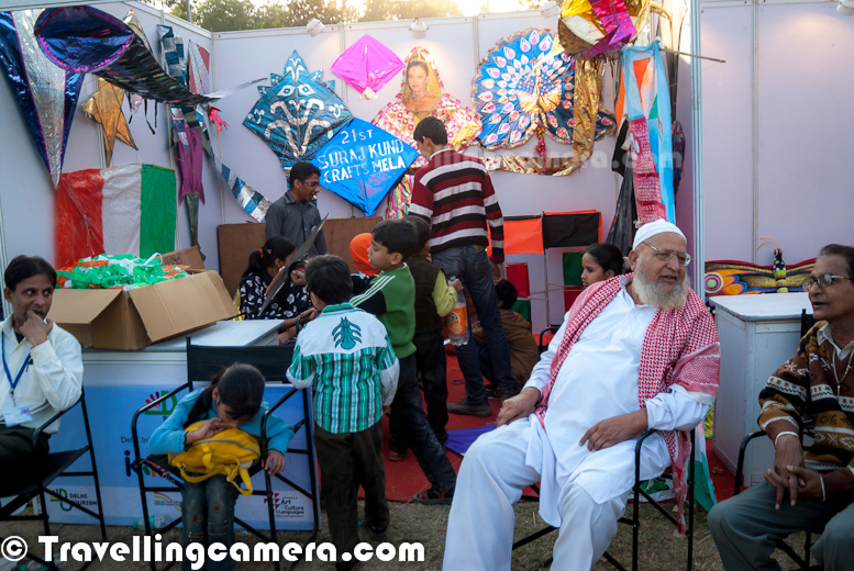 Last weekend (8th & 9th December 2012) I went to Delhi Tourism's 2nd International Kite Flying Festival, hoping to catch some nice Kites in flight.But I was pleasantly surprised to see Bhai Mian, the Godfather of Indian Kite Flying, sitting there in his spotless white kurta. Let's check out this Photo Journey to explore more about the sameHere is the Kite Flying King sitting inside his kiosk of amazing kites. He was surrounded by media people most of the time and I was continuously waiting for meeting him again after one year.Here is Bhai Mian's Son, Jamal, who is also a professional kite flying expert. He also runs an Academy in Delhi for Kite Flying. Does it sound strange? Yes, he is a Kite Flying consultant with many corporates and his main business revolves around Kite flyingBhai Mian along with his family has worked for Kite flying needs of various corporates and various government institutions. In fact, many times kites we see on 15th August are made by Bhai Mian only. Most of the politicians know him very well ! Bhai Mian surrounded by kids all around @ Delhi Tourism's International Kite Flying Festival 2012 !!!Bhai Mian's team also work for Delhi Tourism, as you can see this huge kite with Delhi Tourism Logo on it