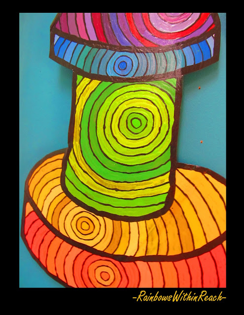 photo of: Artist painting of bright circular forms, rainbow colors,