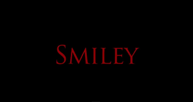 Smiley 2012 psychological slasher film title directed by Michael Gallagher starring Caitlin Gerard, Melanie Papalia, Shane Dawson, Andrew James Allen, Liza Weil