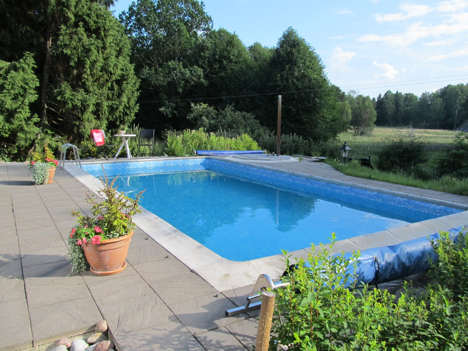 Being in stockholm july 2011 for Swimming pool garden designs