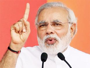 Nandan Nilekani's Aadhaar project a political gimmick with no vision: Narendra Modi -ET 9/4/2014