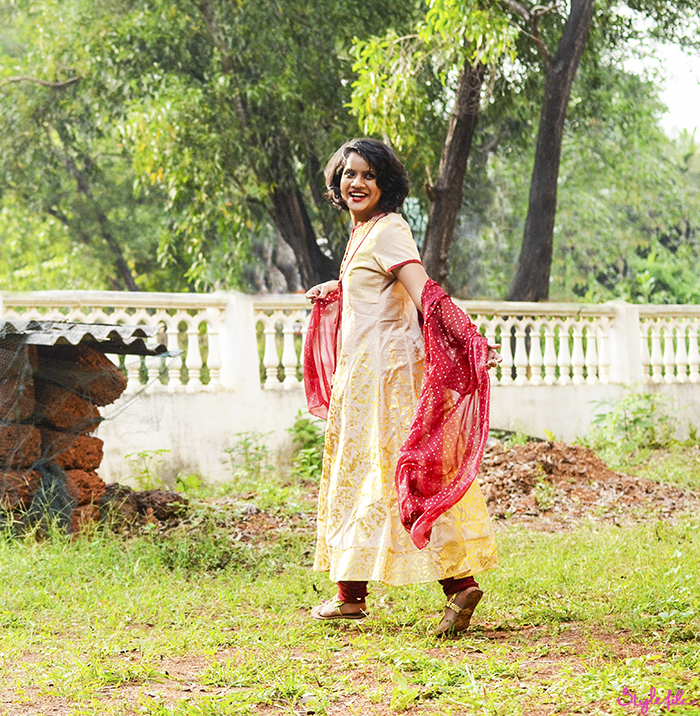 Dayle Pereira, blogger at Style File, starts the festive season in India post Diwali in a traditional salwar kameez Max Fashion India suit in ethnic shades of red and gold with a red lip and gold accessories