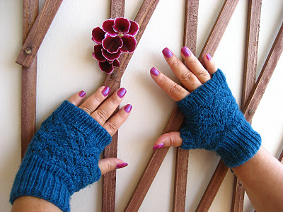 http://buttonsandbeeswax.com/patterns/mitts-and-gloves/nordic-lace-mittens-knitting-pattern/