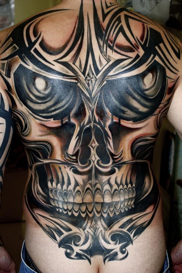 Spooky black grey skull tattoo on back for men