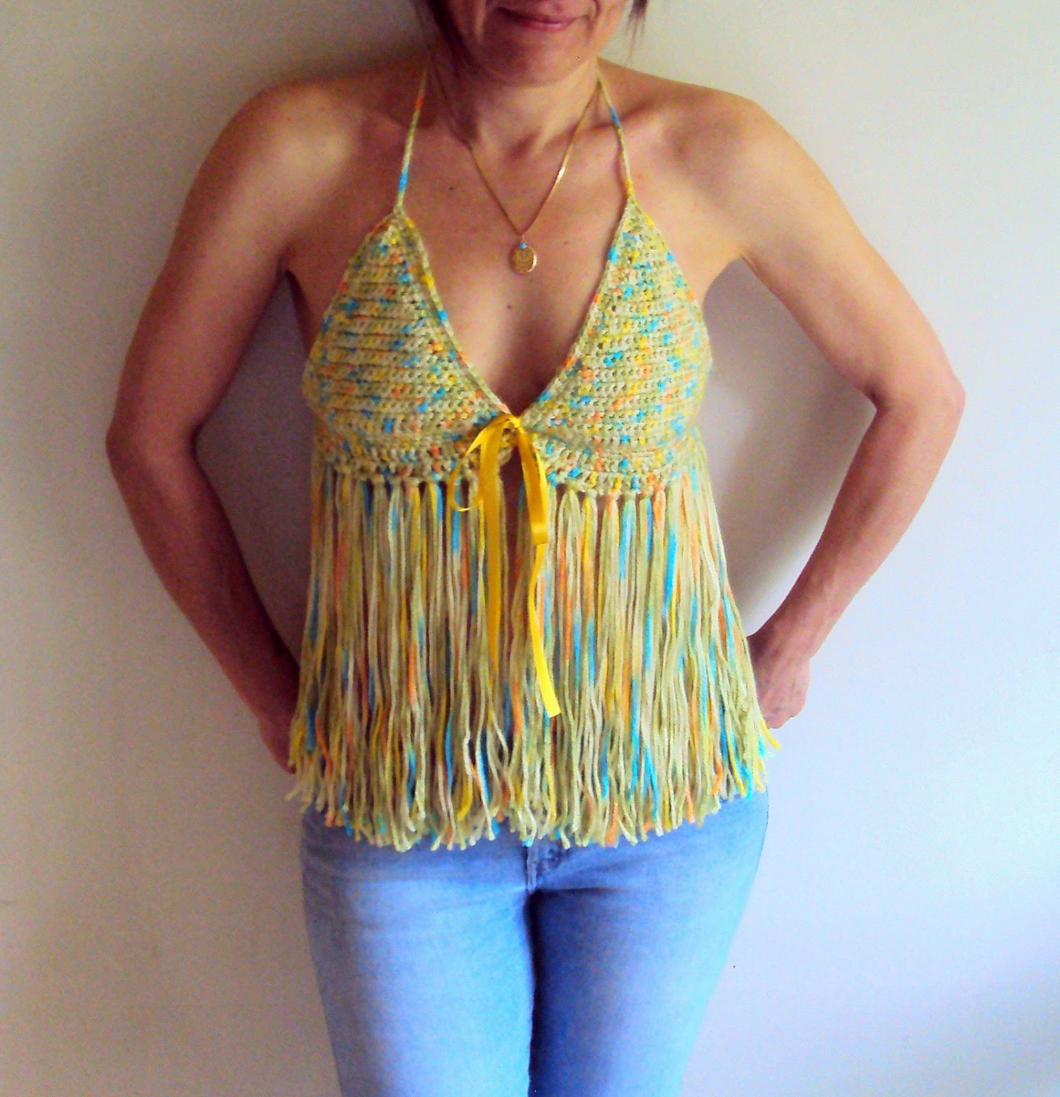 https://www.etsy.com/listing/155202655/crochet-festival-top-fringe-top-boho?ref=shop_home_active_14