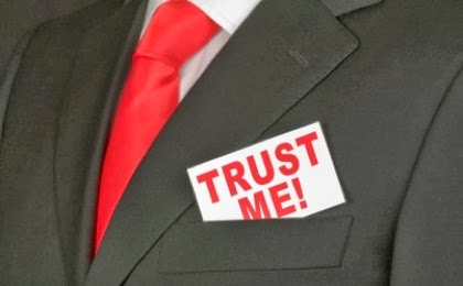 14 Surprising Things That Inspire Trust  - man suit black red tie tuxedo trust me card