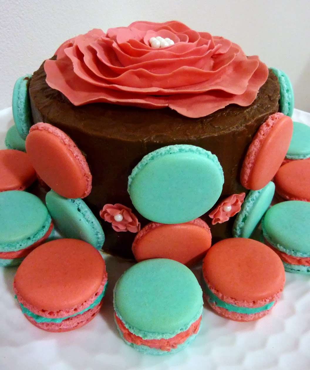 Chocolate cake with peppermint buttercream filling, fudge frosting and peppermint macarons